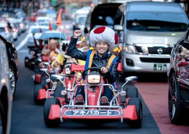 TOKYO, JAPAN - NOVEMBER 16: Participants drive around Tokyo in Mario Kart characters for the Real Mario Kart event in Tokyo on November 16, 2014 in Tokyo, Japan. The organizer calls for participants to this event held about once a month on Facebook, and Akiba Kart offers rental karts that can be driven on public streets. (Photo by Keith Tsuji/Getty Images) ORG XMIT: 522846165